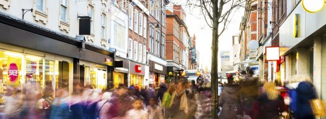 Shoppers hurry past in post-Christmas sales frenzy 2013.